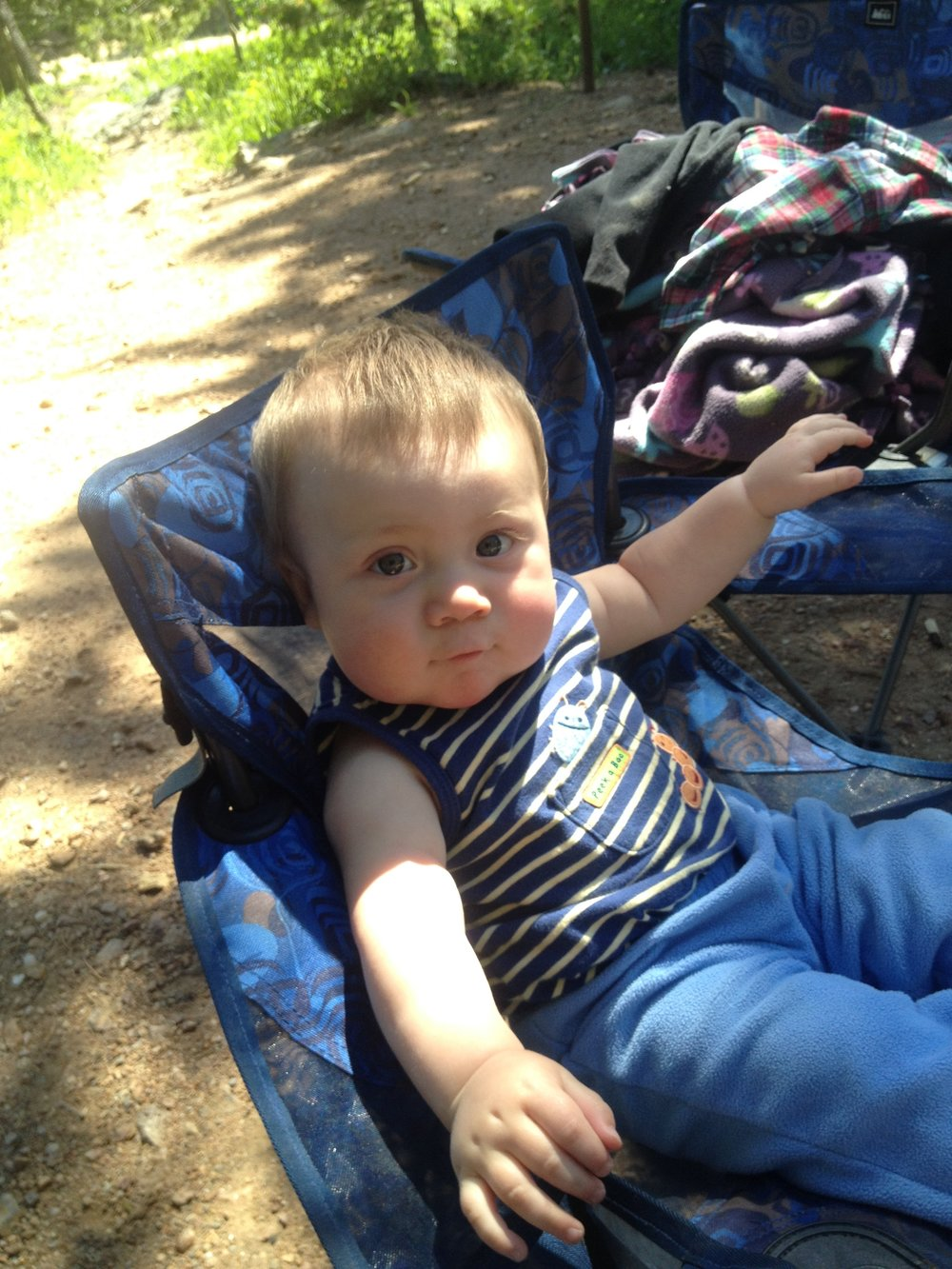 My youngest feeling right at home on a camping trip!