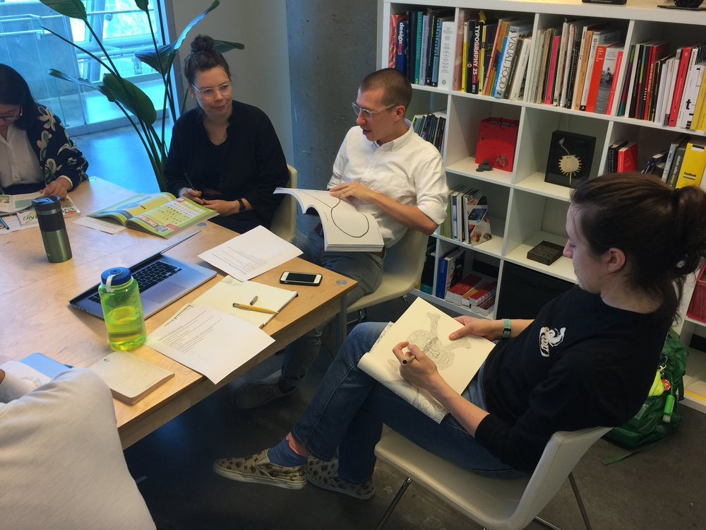 Katja Fluekiger,Jarrett Fuller and Brooke Thyng brainstorming.