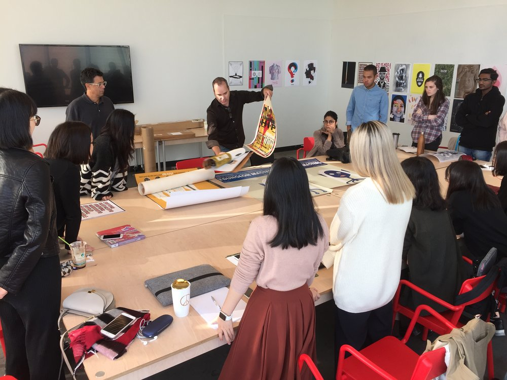 David Plunkert drops by GD MFA Studio to talk posters with the class of 2018