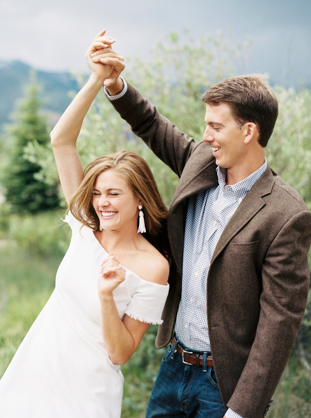 Groom twirls bride in Telluride Engagement Pictures by Top Colorado Photographer Hannah Mayson