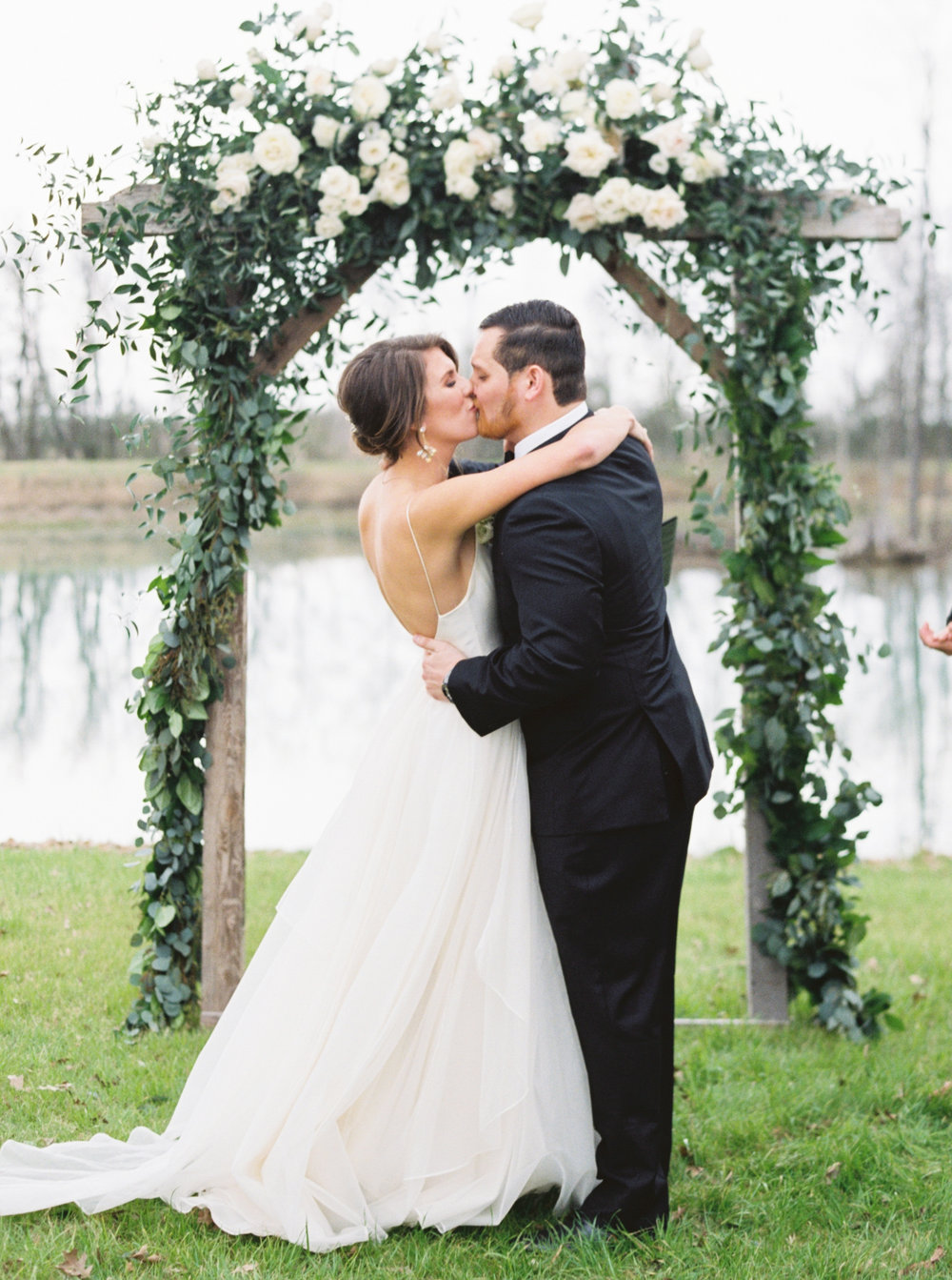 overcast wedding day, leanne marshall wedding gown, neutral wedding flowers, natural flowers, floral arch