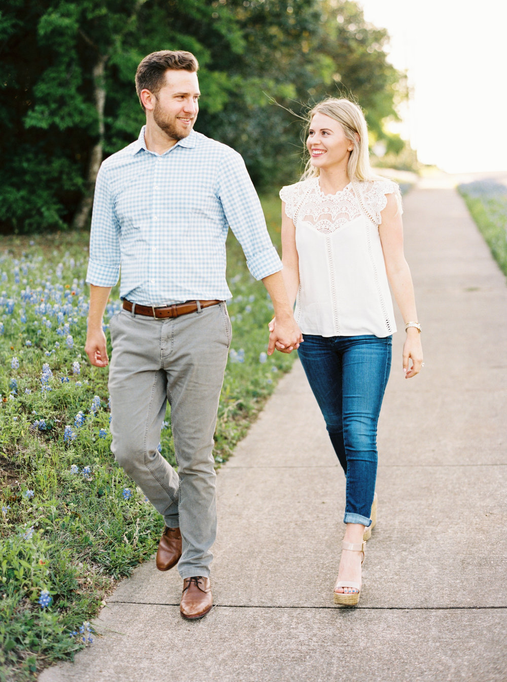 Couple walking bluebonnets