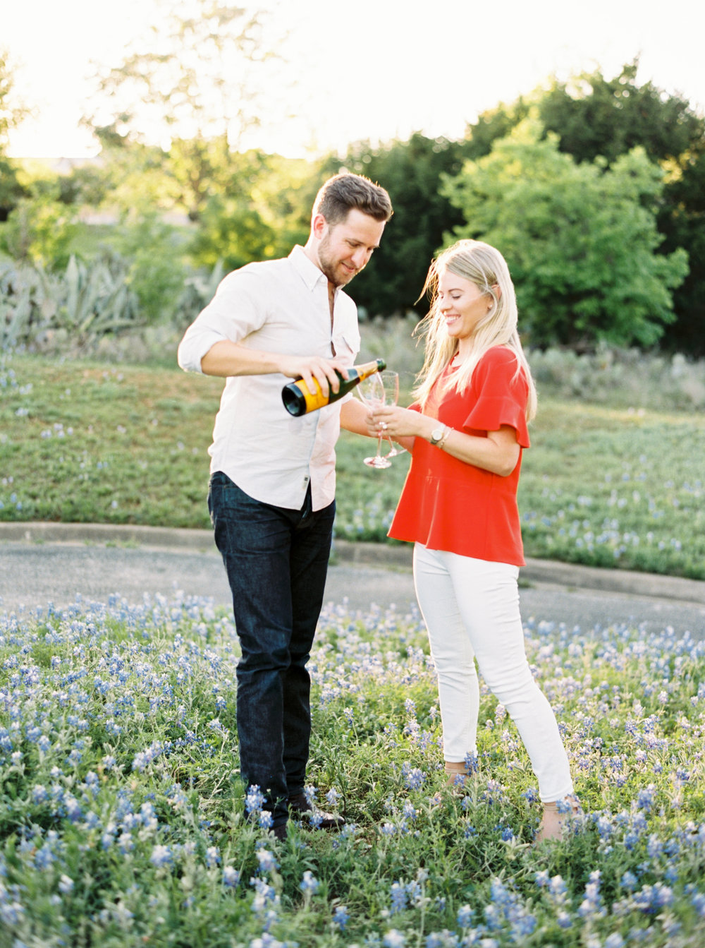 popping champagne during engagement pictures