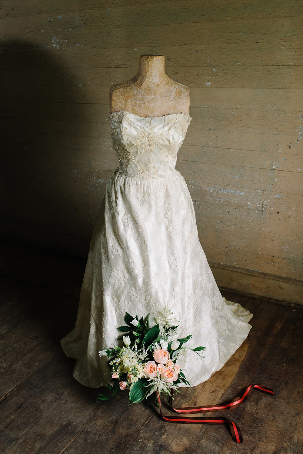 This wedding dress was worn by both my mother and sister.  It was a thrill to take it out of the box before the shoot and remember my sister's wedding day.  It was the first wedding I had ever been in.  Photo:  Norman Photo and Paper.