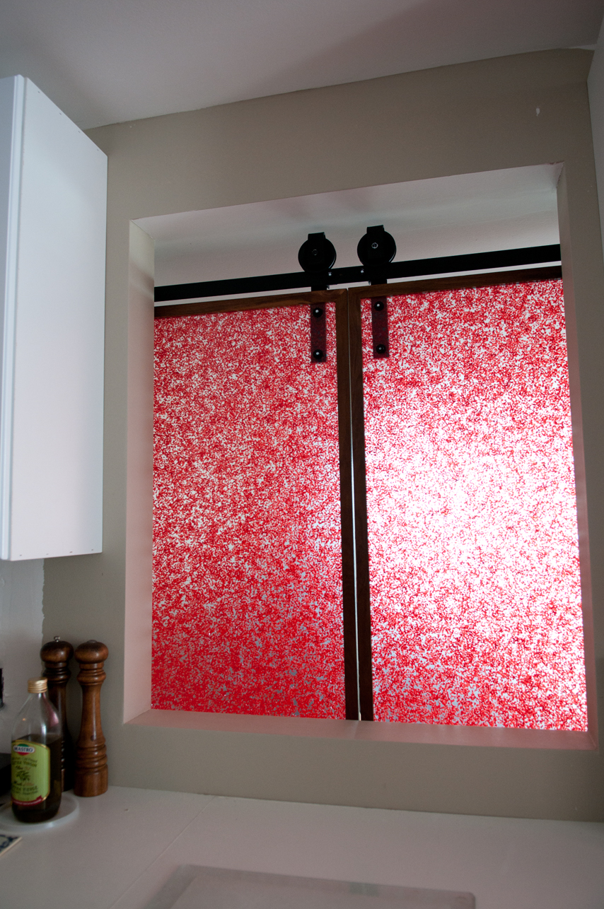 This is special acrylic has  actual crystals embedded to give a cool effect, like the Japanese floral panels.    Our client bought the acrylic, and we picked it  up, cut it to size and framed it.