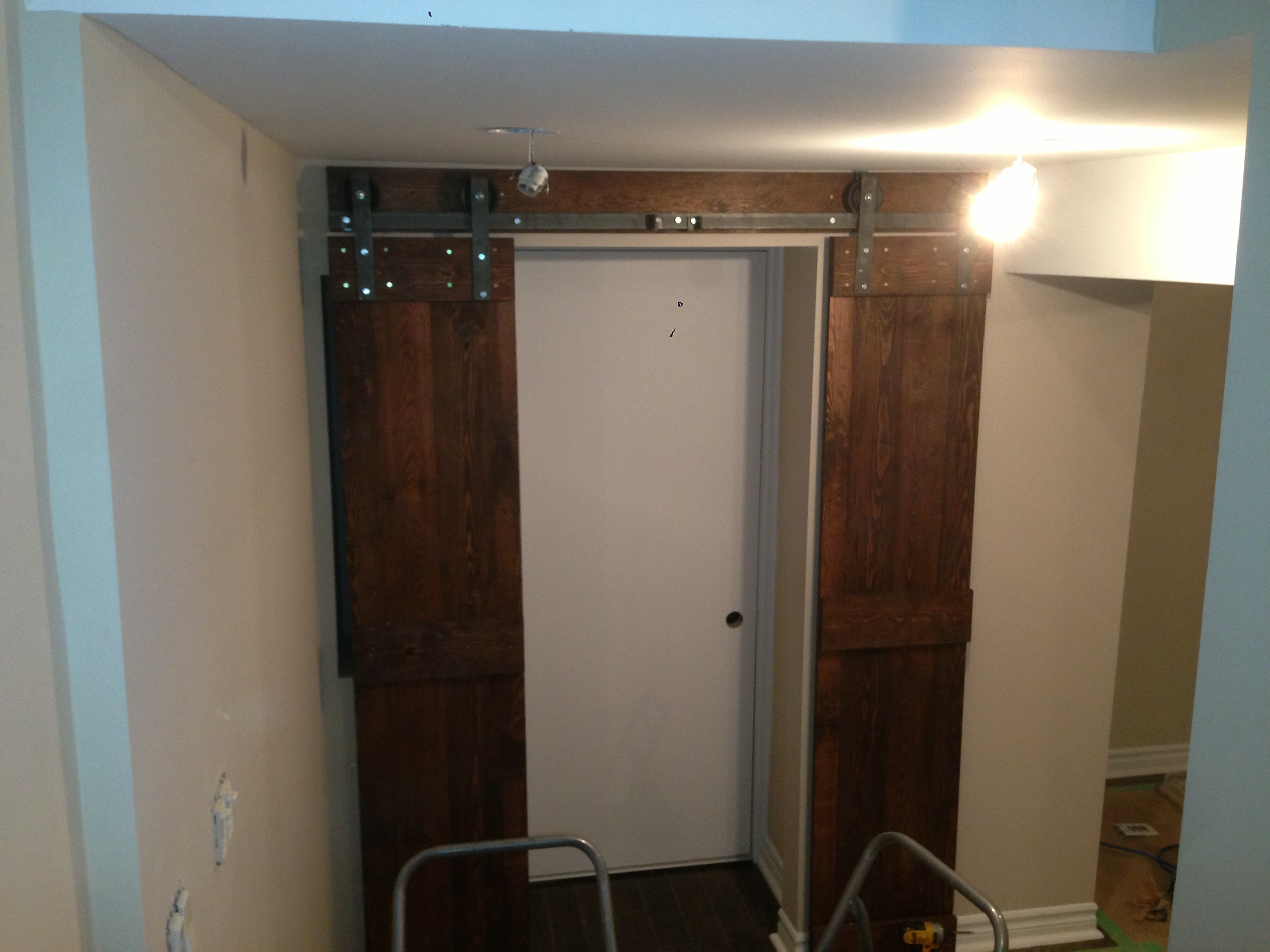 Two small barn doors to cover a clothset.