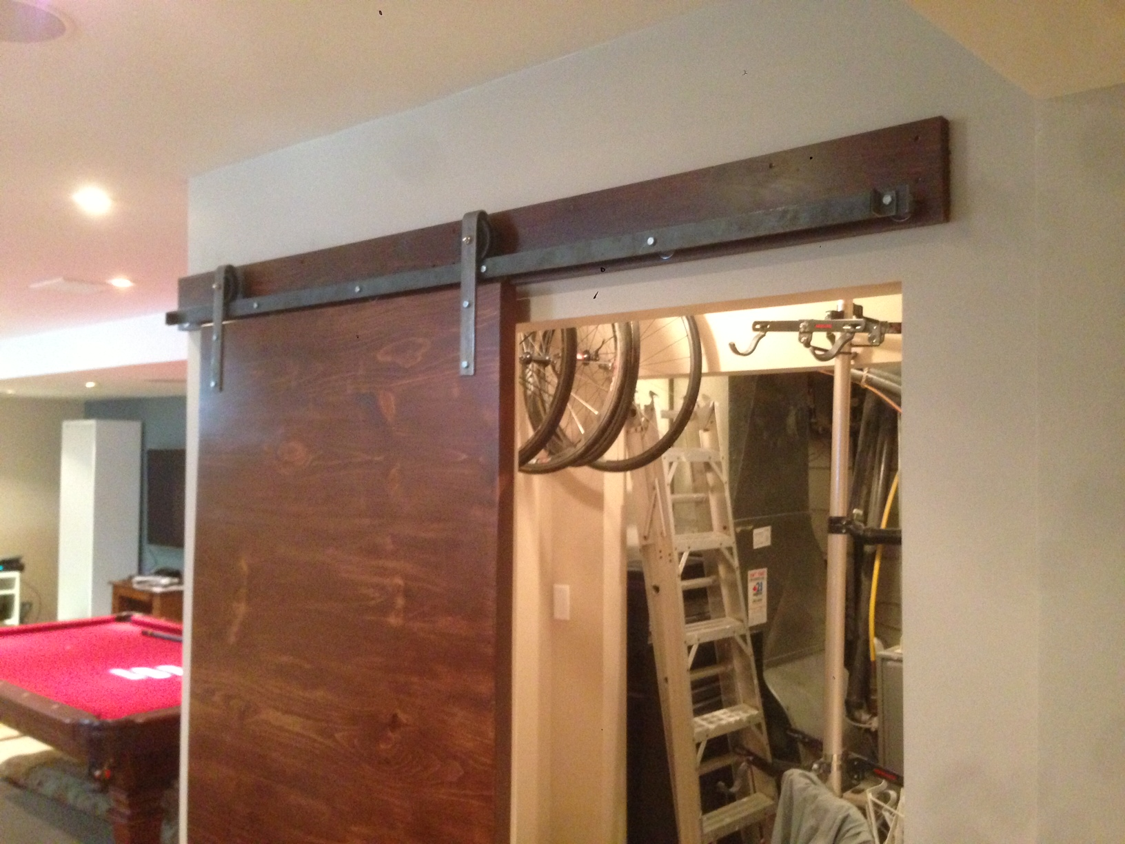 Looks like all the fun is store away in fashion!  Who wouldn't want the door to their storage room be a slab sliding barn door?