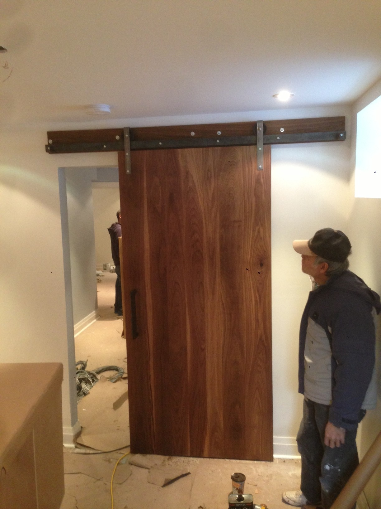 Just after the installation.  This is the entrance to a laundry room in the basement (a fancy one, I imagine), but it's because it's the first thing one sees coming downstairs, it's worth all the while to install this beautiful walnut door there.