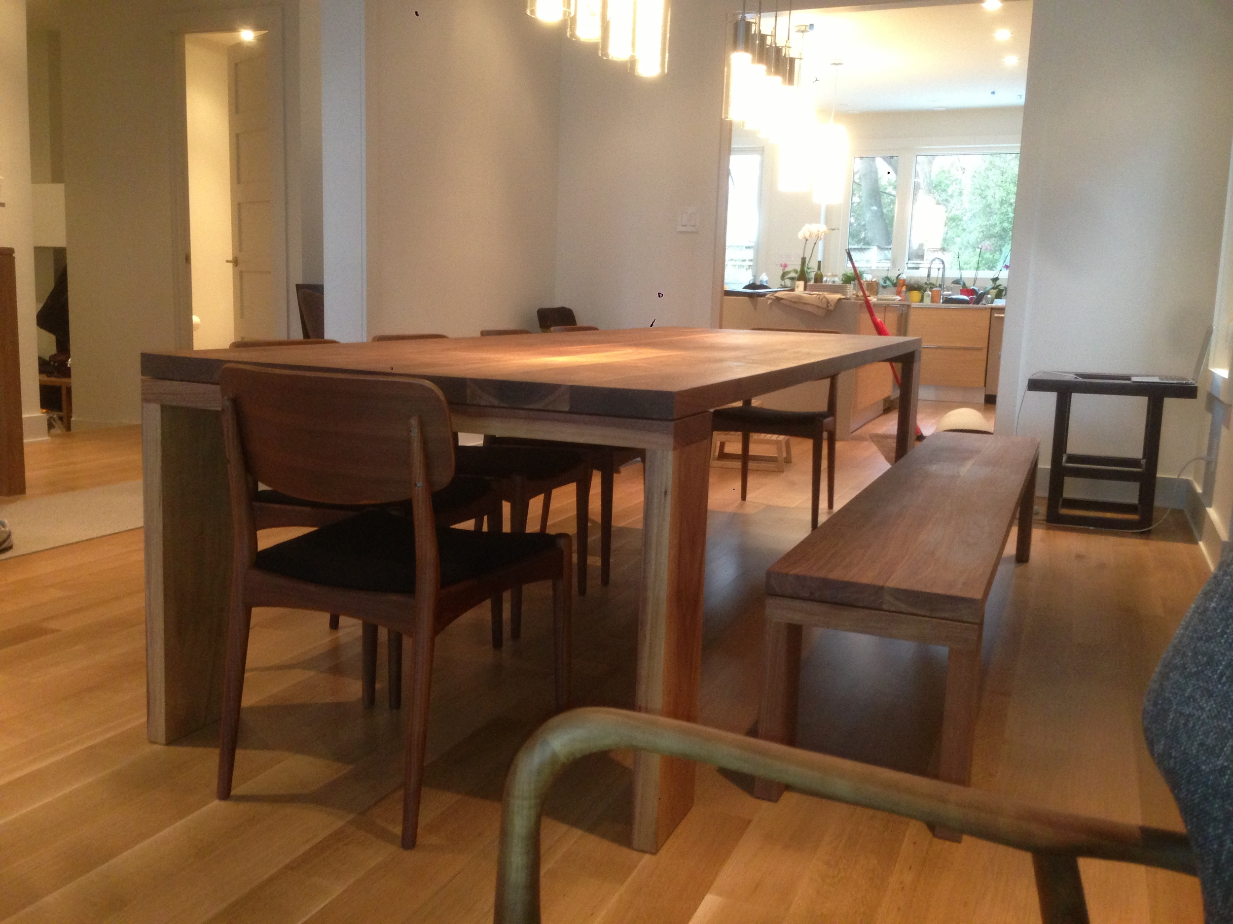 This Long Feast walnut table is 42 inches x 10 feet with a matching bench that is 8 feet long