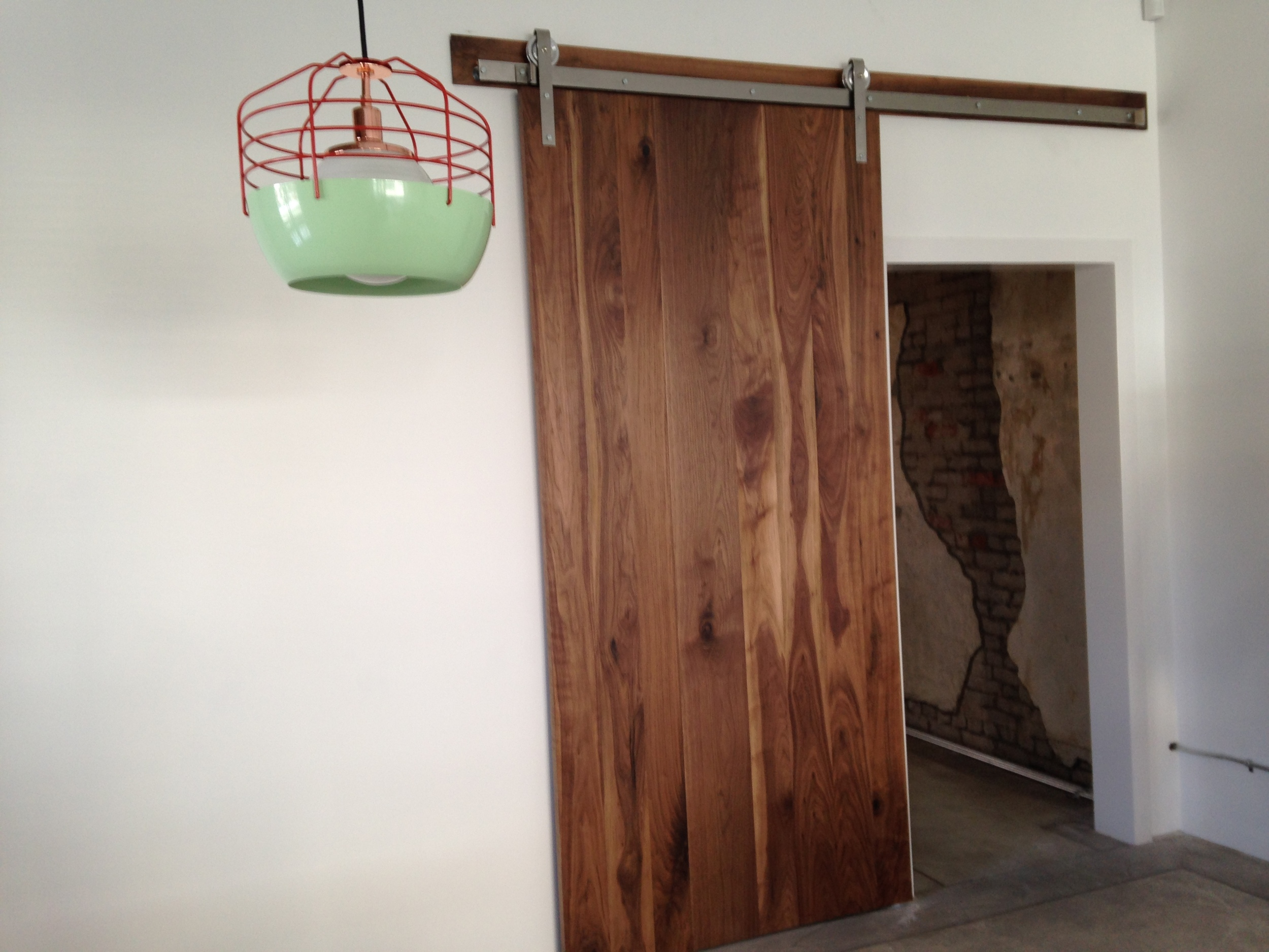 That pendant is quirky, and charming and just goes perfect with that sliding walnut door!