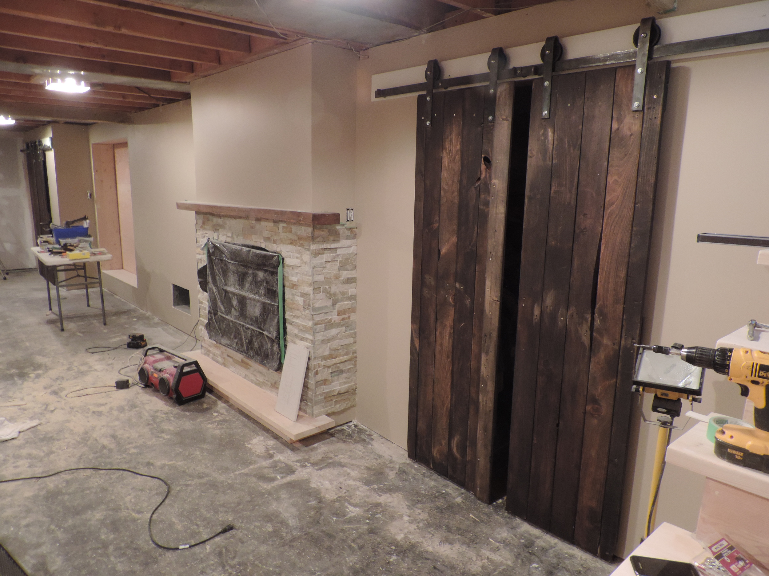 Michael from Sudbury made the doors himself using knotty pine, and hang them on the biparting barn door hardware for a wow factor in his basement. Great job Michael.
