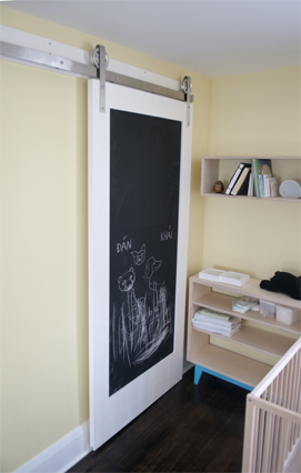The older baby has already chalking up the door, hopefully, that stops him from marking up the walls!