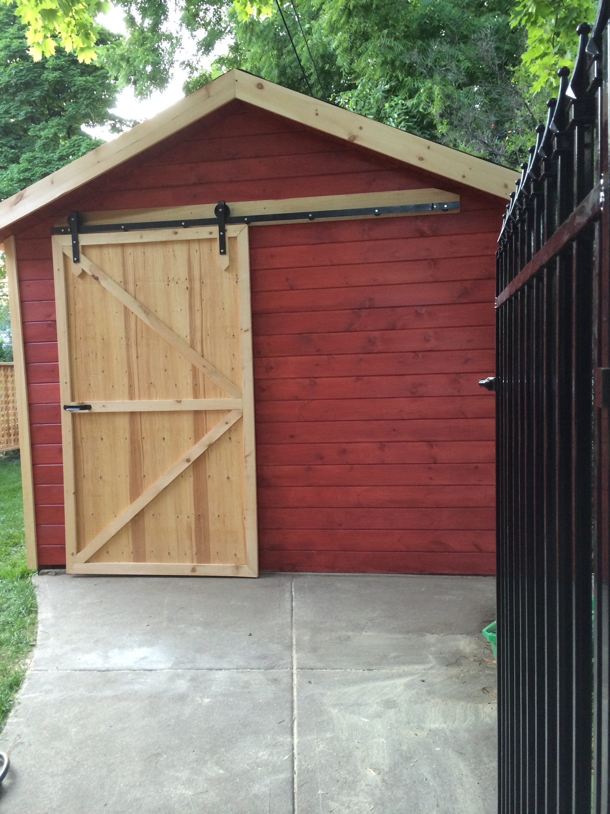 Our client just sent this in. She made a city barn out of her garage, and that special element that makes it a barn is the barn door hardware where a barn door can slide back and forth, can't do without it!! Yay for the barn door! It just looks so cute to cozy.
