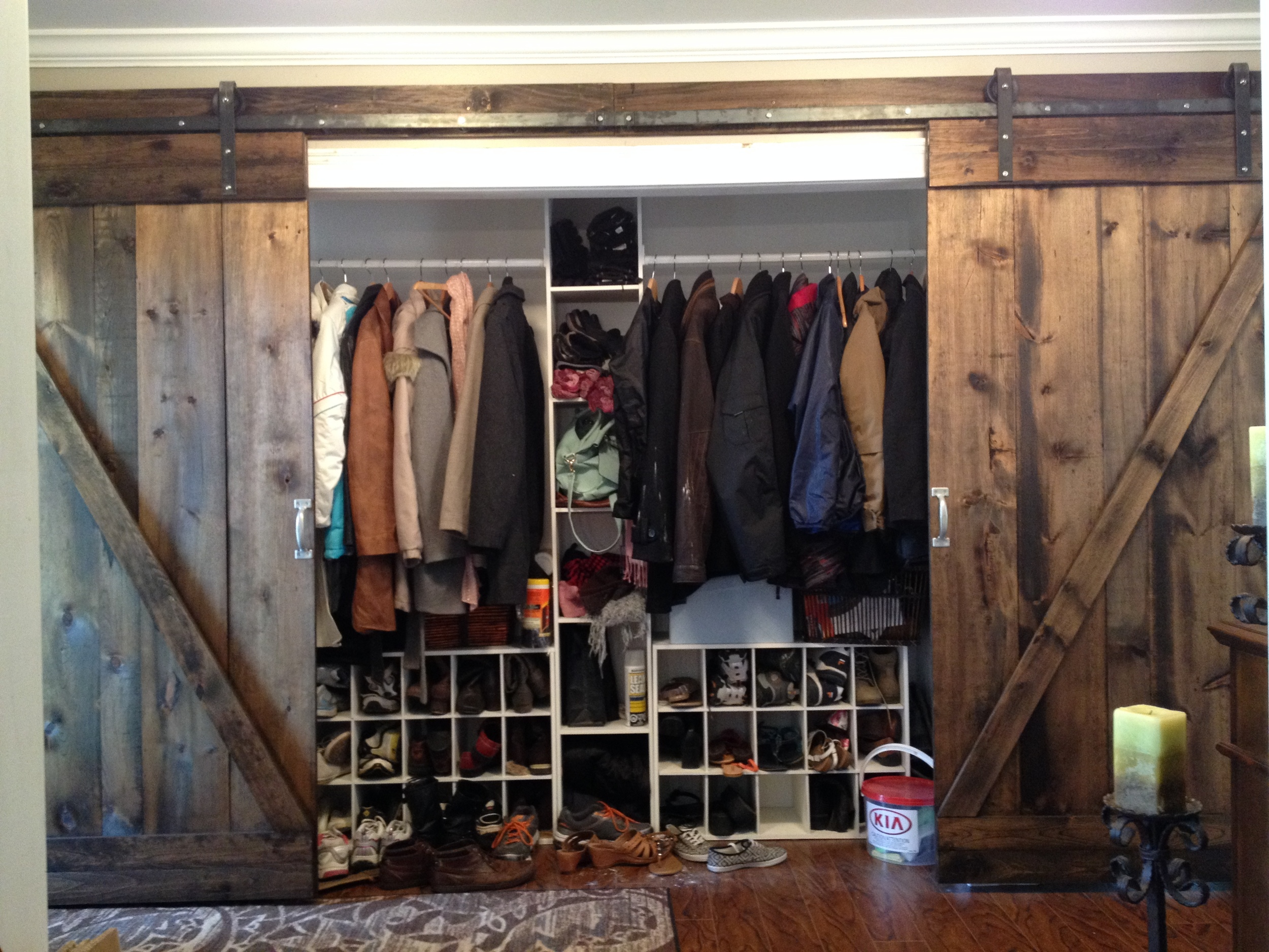 This looks like a coat closet! Wow, so much room. And it can all be covered up in style with a slide of these lovely doors our client made himself.