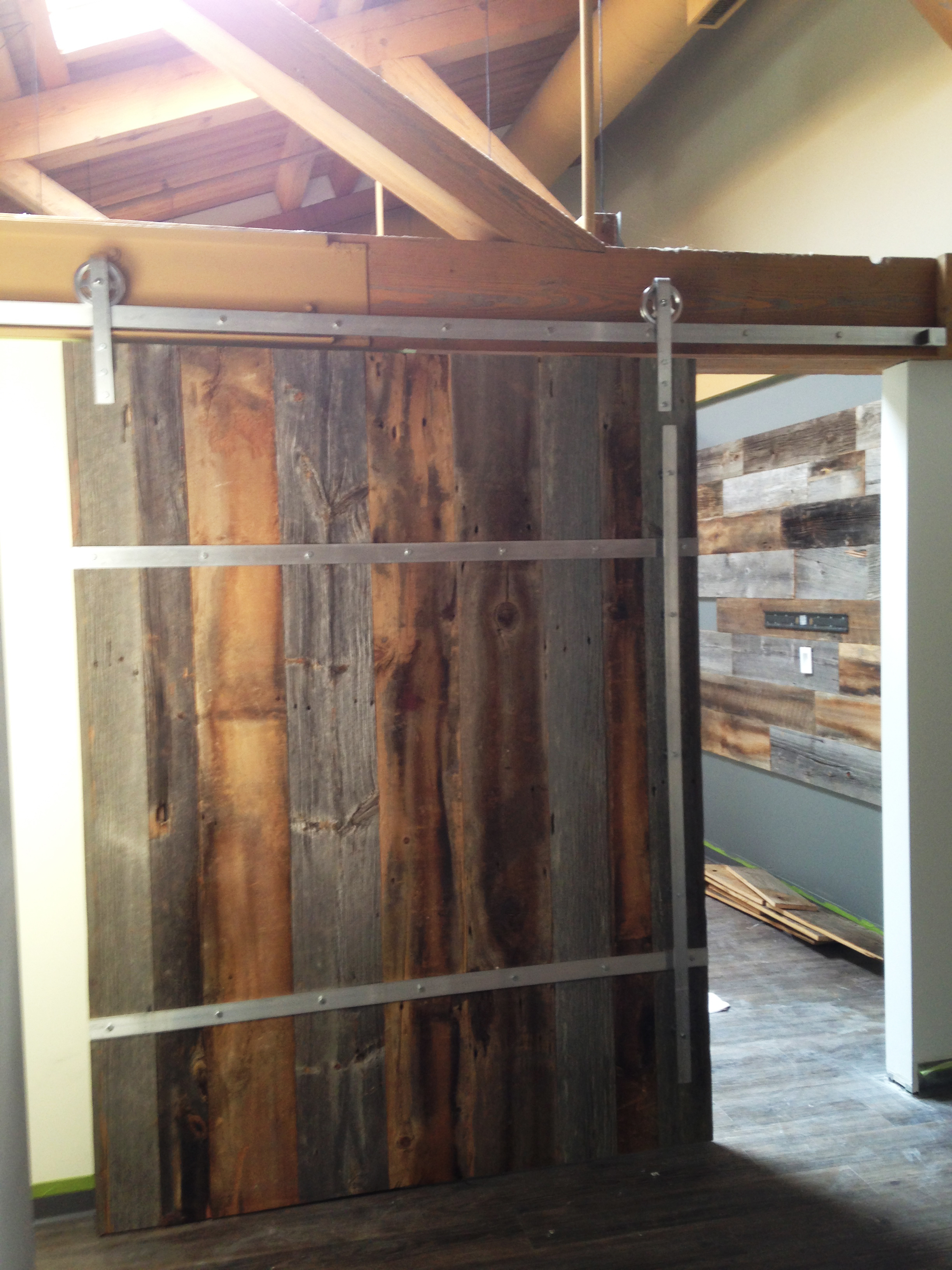 Notice there is a featured wall inside the room with barn board cladding.