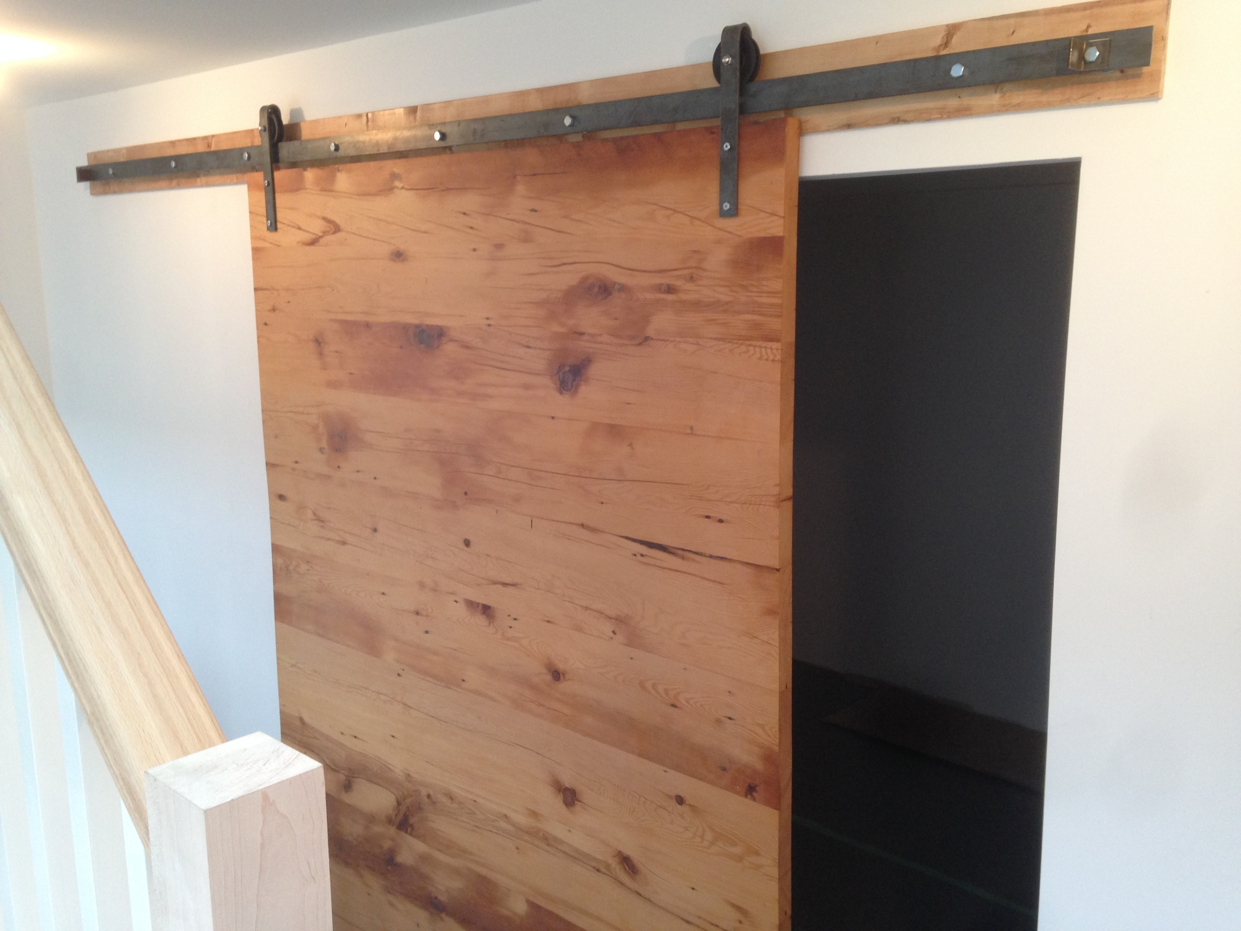 These joists were old old pine. They were milled down to make a slab door, but still retained enough character to speak to the history of the house.