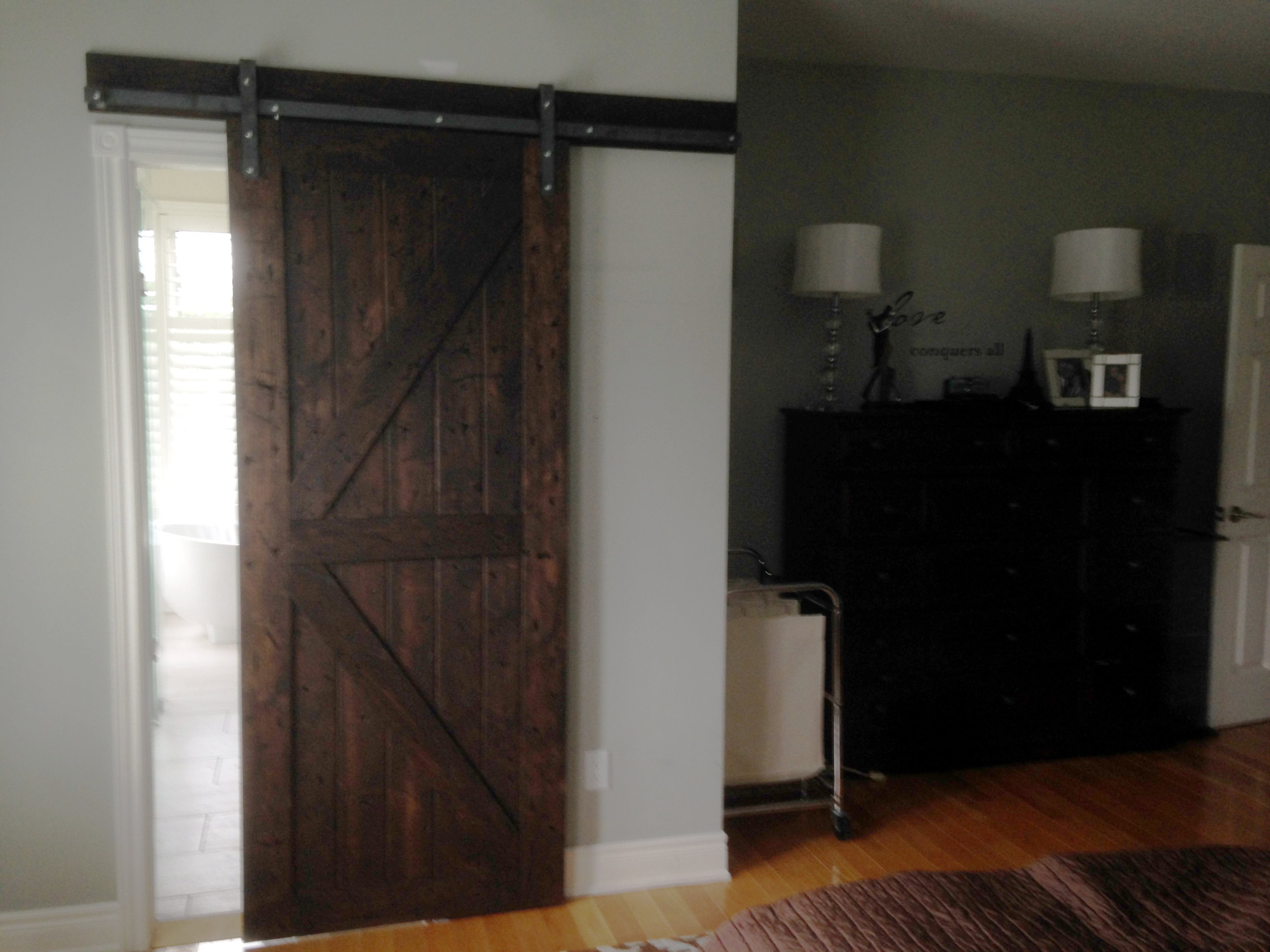 This door was made from pine and hand distress and finished with dark stain.