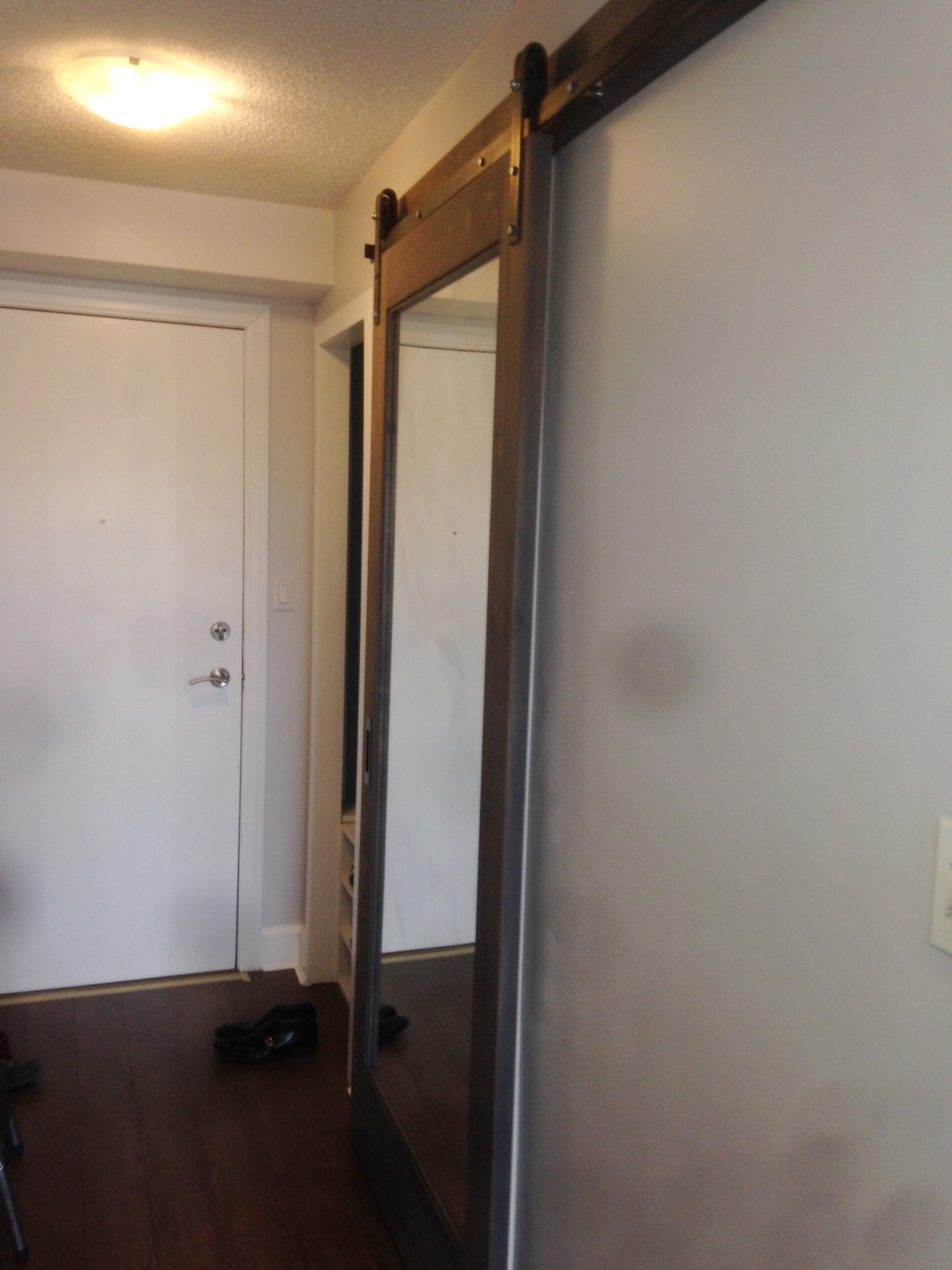 Because our client does not have a full length mirror in the condo, they thought it would work out nicely if the bathroom is sliding barn door mirror. And so we made it happen.