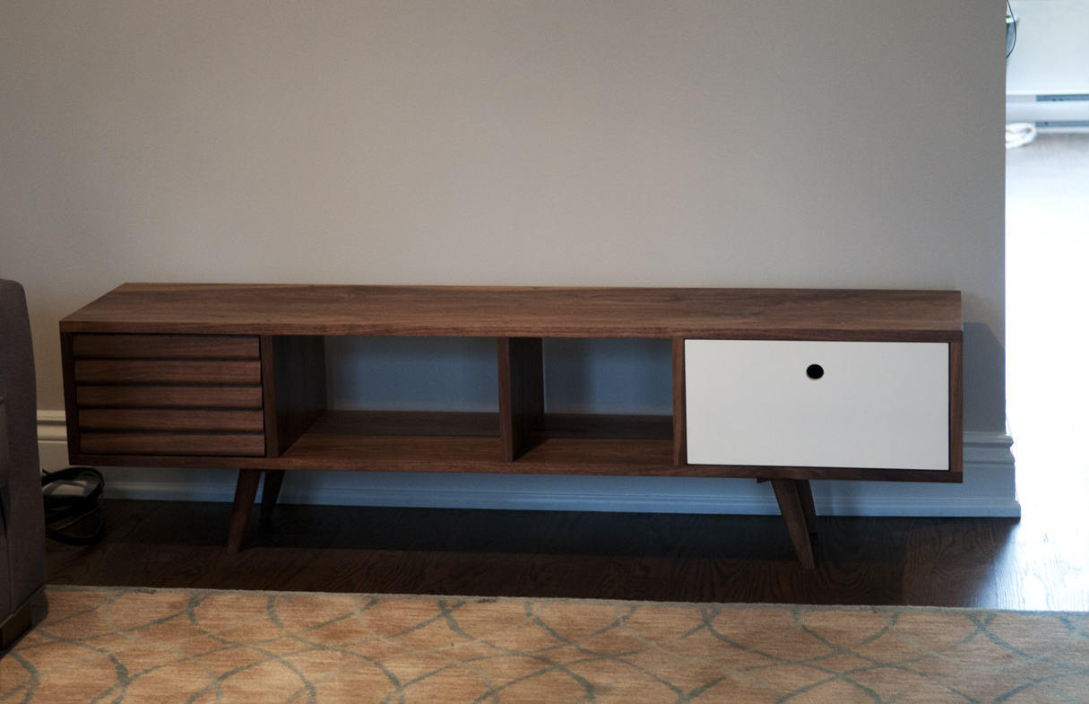 This TV console is made of solid walnut with two drawers. The rounded legs were turned by hands.