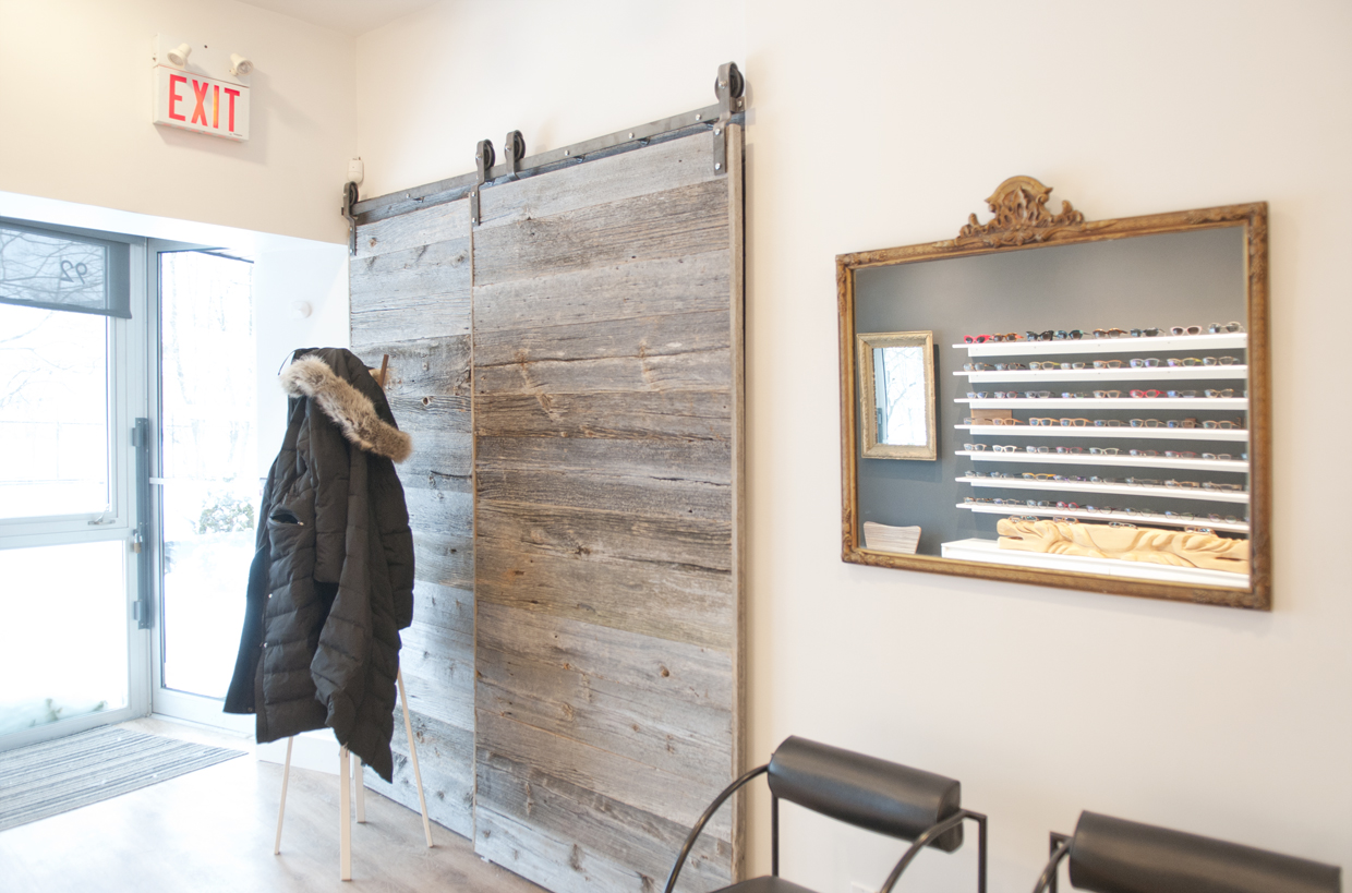 One last look at the barn door. As you can see, the horizontal lines of the barn boards mimic the horizontal lines of the shelves for the frames creating an echo that bounces back and forth across the walls.