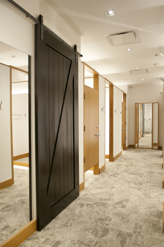 The two black barn doors are for the fitting room upstairs, both to cover an access to the window display.