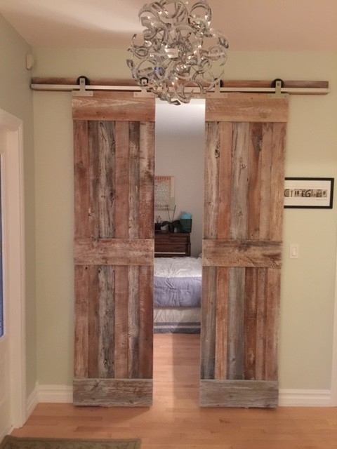 These doors opens up to the guest bedroom. They are sliding on the T-slide barn door hardware.