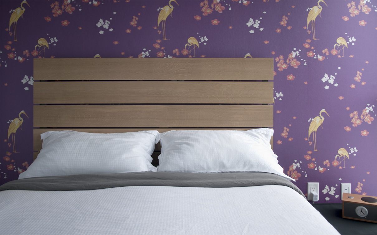 Birds, birds, birds. This awesome wall paper is the perfect backdrop for the bed, and bedroom.