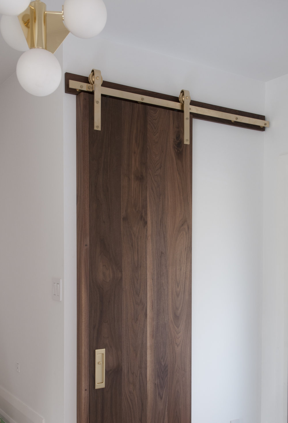 brass_hardware_walnut_door_01.jpeg