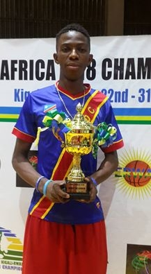 Photo of Patrick Mwamba with his trophy as the best shooter in the tournament.