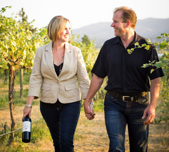 Kristina & Jim walk the Arbor Crest vineyard