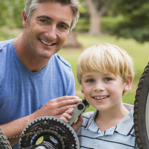 dad-fixing-bike-with-child.png