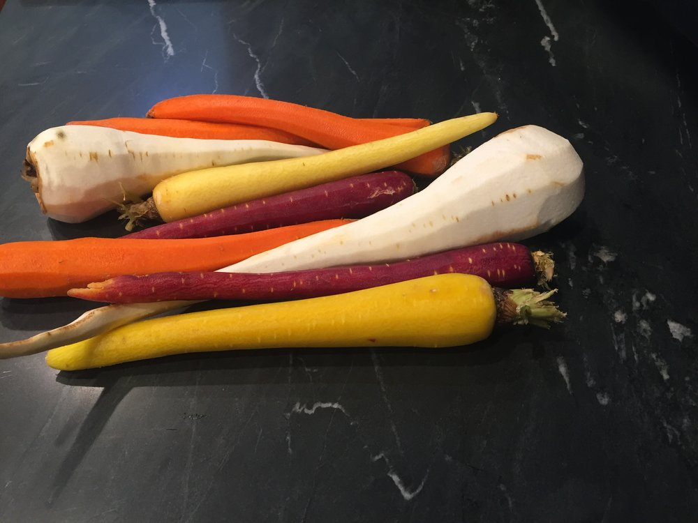 Look at these stunning heirloom carrots and parsnip that I got at the farmers market this weekend.