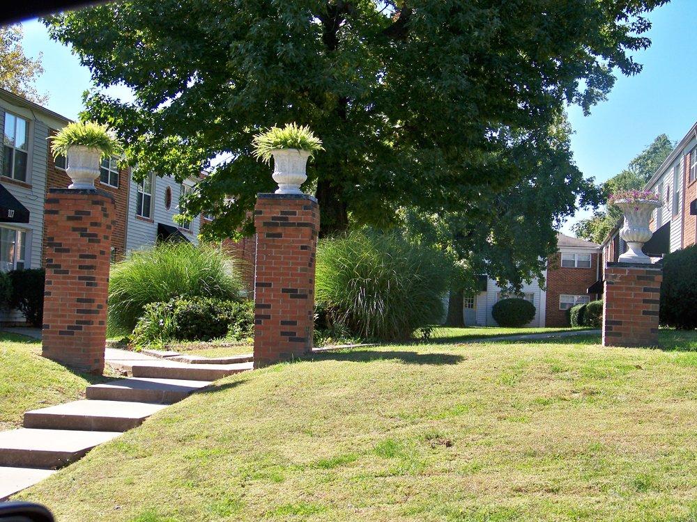 maple manor pillars with plants.JPG