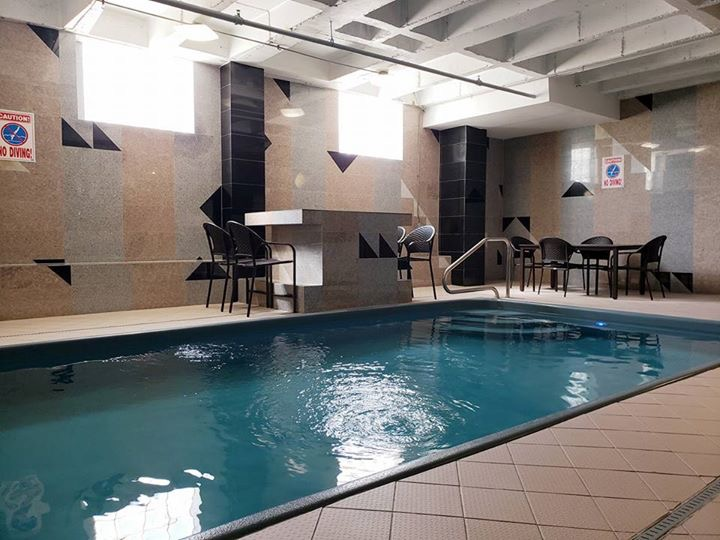 - Amenities include an indoor heated pool and hot tub. Personal service and safety are our top priorities with attached gated parking, secure entrance and 24 hour video surveillance.