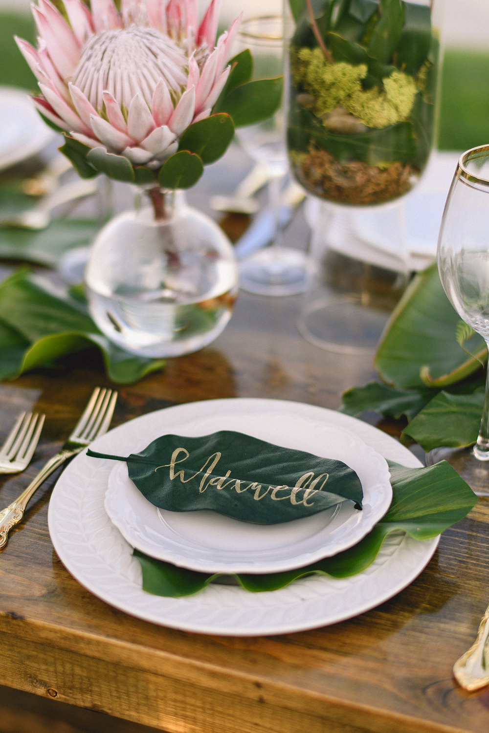 Tropical Leaf Place Card Calligraphy  Photography:  Sage Justice Wedding & Portrait Photography  Wedding Planning & Design:  Love Marks the Spot  Floral Design:  Haydee's Creative Flowers  Venue:  The Catamaran Resort Hotel