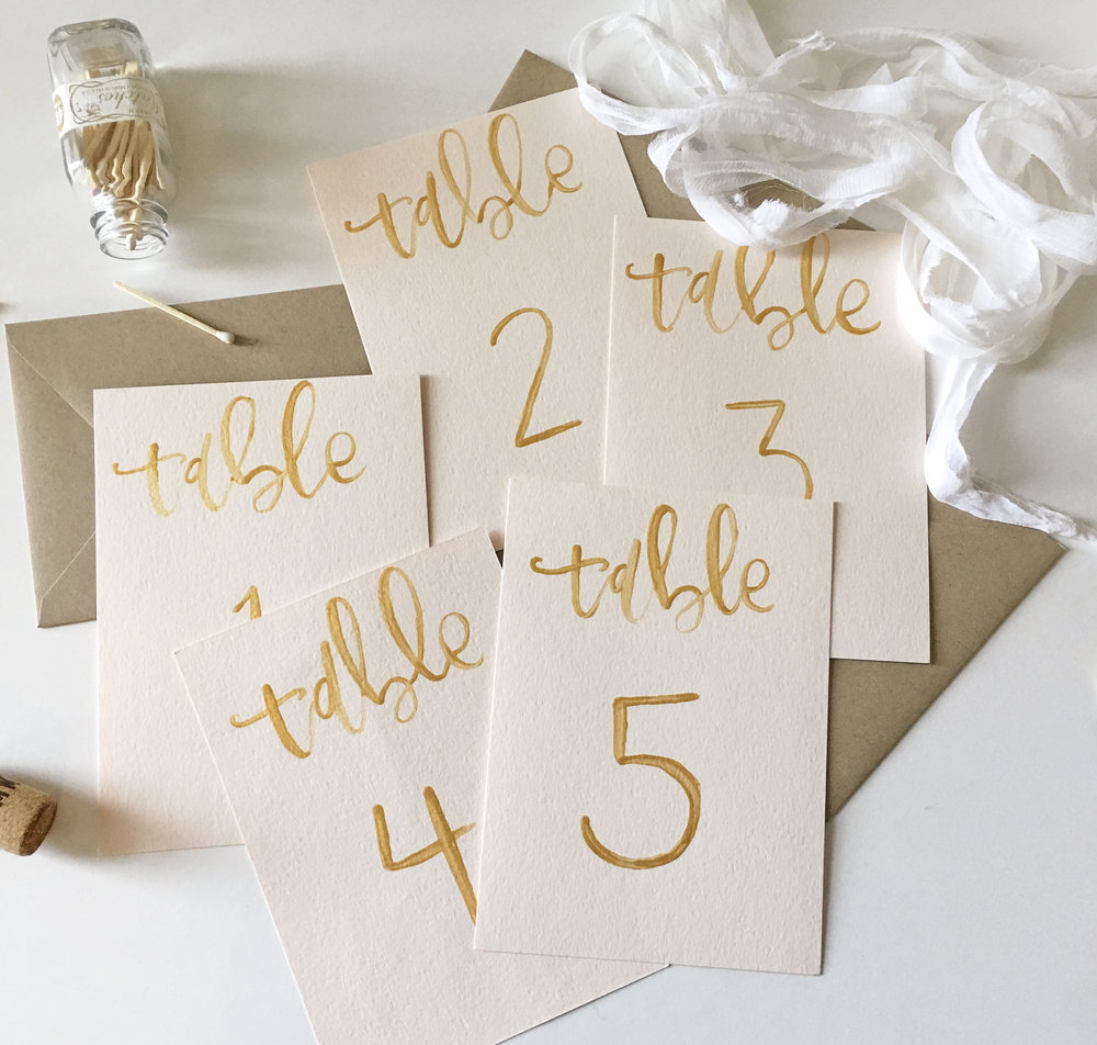 Gold and blush brush calligraphy table numbers