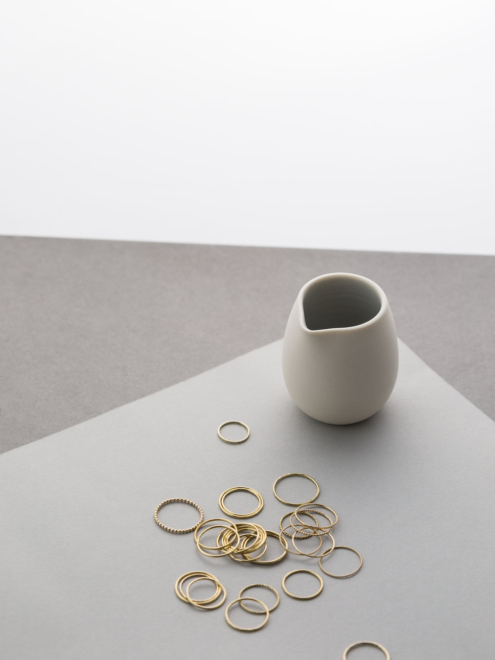 Porcelain Vessel: PIGEON TOE CERAMICS.  Rings: ADRIA, AIRE Stacking Rings