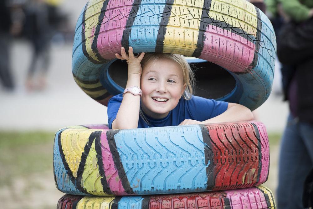 Kid in Tires.JPG