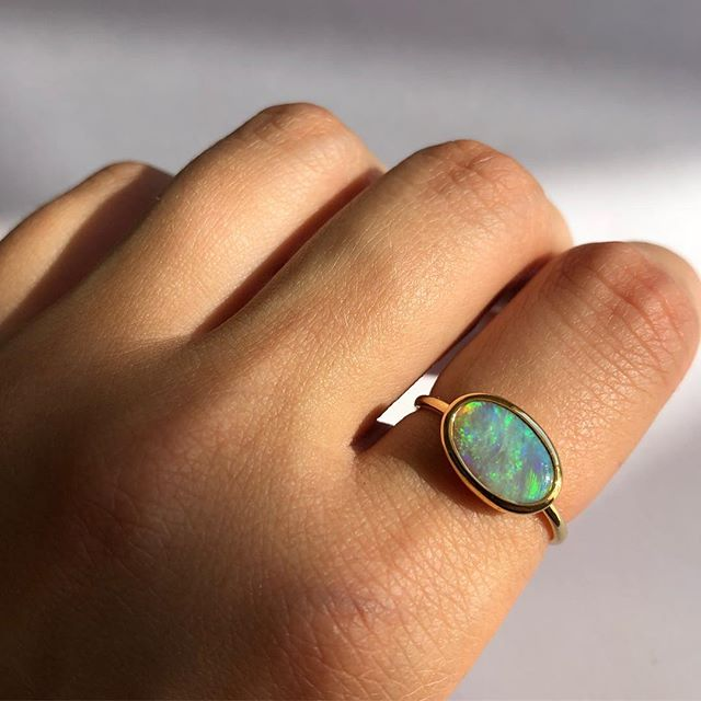 The light / form ring with blue - green opal 〰️ amazing colours in this ring. Dm or email for sizing and other inquiries ✨