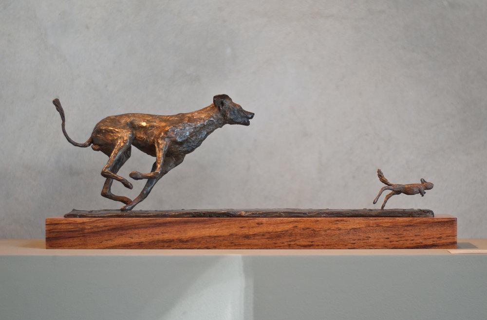 Wild Dog chasing Springhare R28 560.jpg