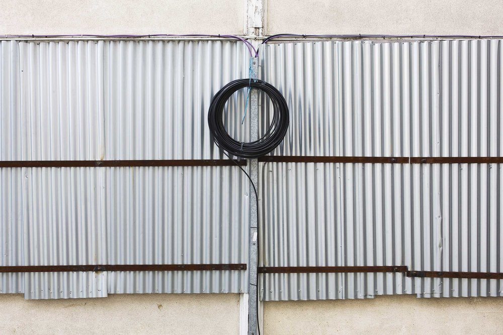 black cable on metal fence.jpg