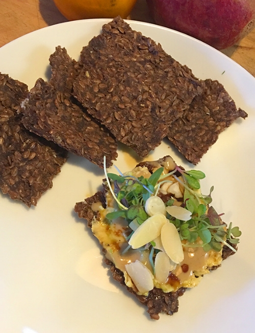 My raw vegan flaxseed crackers, made in dehydrator, with vegan cheese, tahini, sprouts and almonds. One of my favourite in between meals snacks.