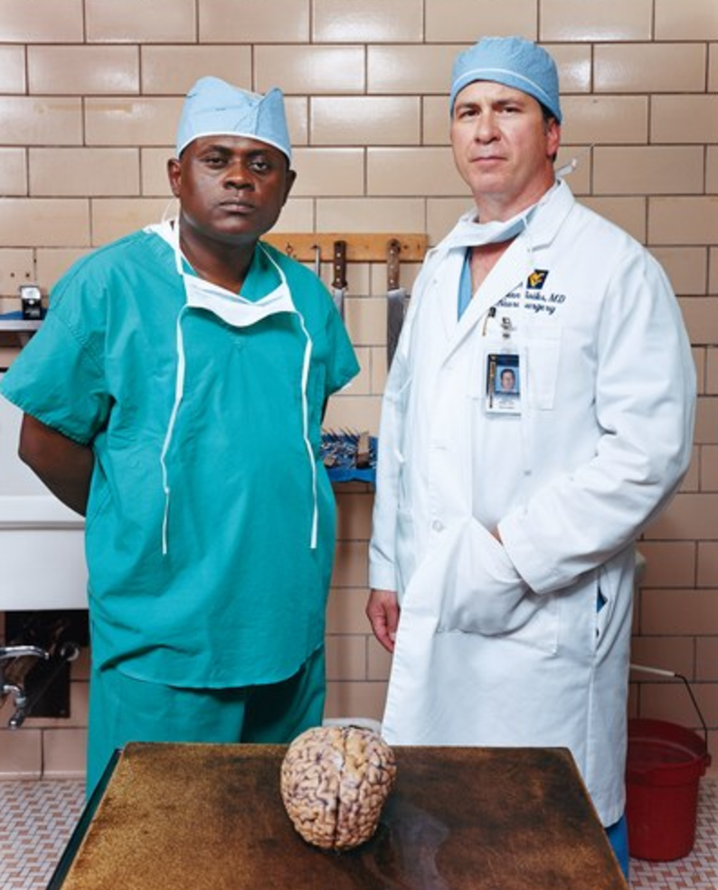 Doctor Omalu (left) with partner Doctor Bailes (right) (Photo by GQ)