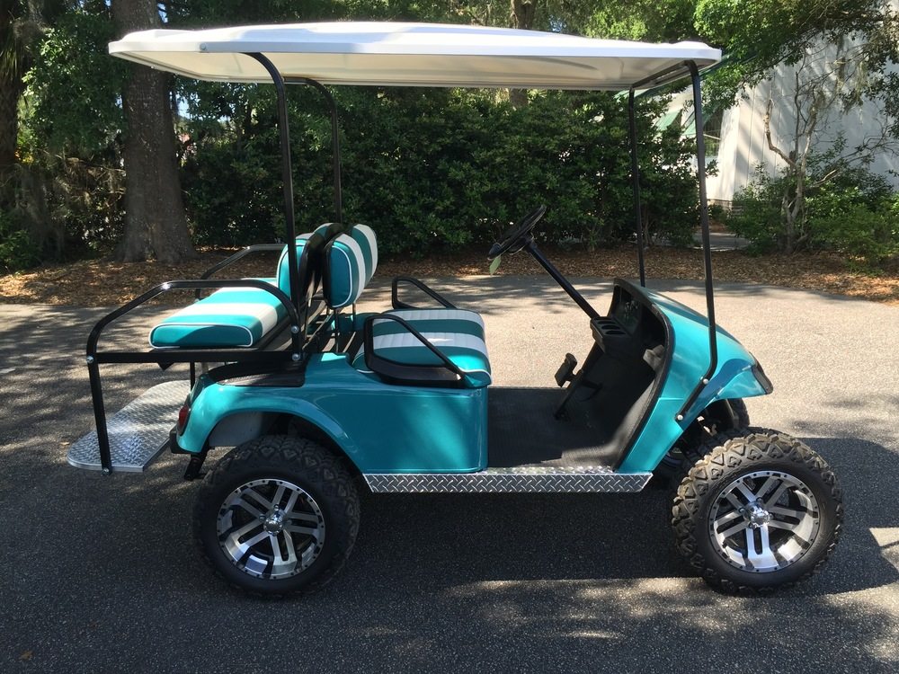 Emerald EZGO Lifted Cart                 Emerald/white seats, white extended top, new (2017) batteries, high speed code, LED lights, Backlash (23x10x14) tires, mirror, flip windshield, and state of charge meter
