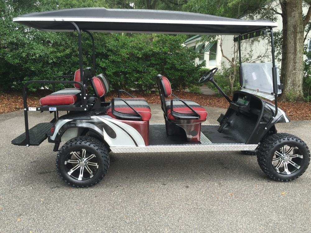 Garnet Swirl EZGO Lifted Trolley Garnet/smoke/black seats, black top, new batteries, high speed code, LED lights, Backlash 23x10x14 tires, state of charge meter, mirror, and flip windshield