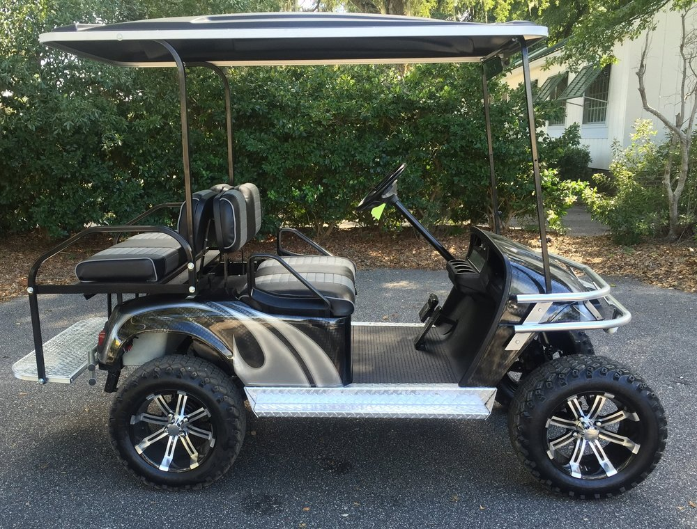 Charcoal Swirl EZGO Lifted Cart Black/charcoal seats, black extended top, new batteries, high speed code, LED lights, Backlash (23x10x14) tires, mirror, flip windshield, state of charge meter, and chrome package