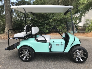 Seafoam EZGO Cart White seats, white extended top, new batteries, high speed code, LED lights, Low Pro tires, mirror, flip windshield, state of charge meter, and personal key switch