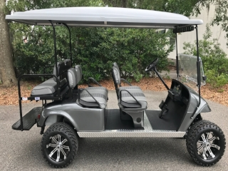 Charcoal EZGO Lifted Trolley Charcoal/smoke seats, gray top, new batteries, high speed code, LED lights, Backlash (23x10x14) tires, state of charge meter, mirror, and flip windshield