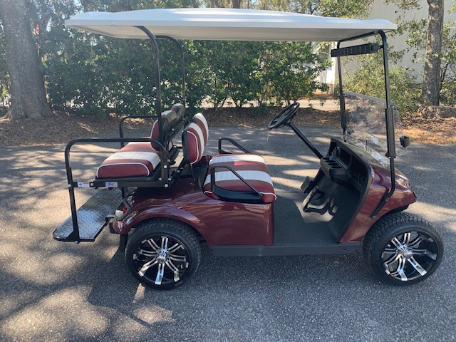 2015 Maroon EZGO Cart —————— In Stock   Maroon/white seats, white extended top, new 2019 (6-8vt) batteries, mirror, flip windshield, high speed code, Low Pro tires and LED lights