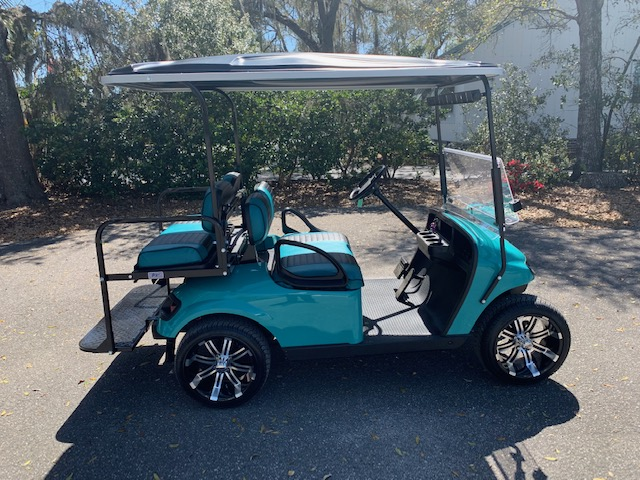 2015 Teal EZGO Cart ——————— In Stock   Teal/black seats, black extended top, new 2019 (6-8vt) batteries, mirror, flip windshield, high speed code, LED lights & Lo Pro Tires